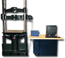 A 60,000 lb capacity Baldwin Universal Testing Machine retrofitted with a new servo-hydraulic console equipped with ADMET's MTESTQuattro® Materials Testing System. The servo based system ensures that tests are performed automatically according to ASTM specifications